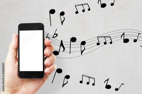 Fotobehang Muziek Empty white cellphone on concrete background