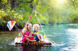 Leinwanddruck Bild - Kids on wooden raft
