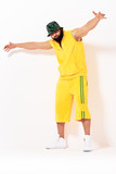 Rap and hip hop style. Young bearded man in yellow cloth on white background. - 208827677