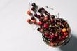 top view of fresh ripe sweet cherries in vintage bowl on white