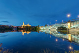 The Cathedral of Salamanca and the river Tormes with the Puente de Enrique Estevan at night - 208857407