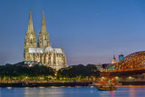 The famous Cologne Cathedral and the river Rhine at night - 208857605