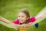 Young girl relaxing on the hammock in garden. - 208866607