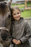 Young horse riding girl, equestrian sport . Horseback girl on field. - 208866842
