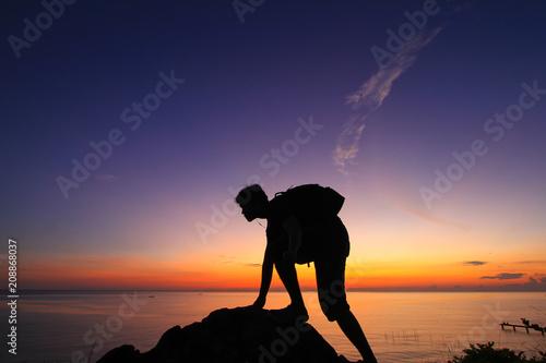 Aluminium Strand Silhouette of a man in the beautiful sunrise.