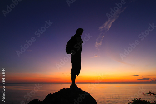 Silhouette of a man  in the beautiful sunrise.