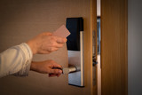 Opening a hotel door with keyless entry card. - 208868201