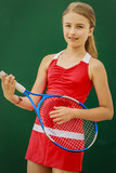 Tennis young girl player on court. - 208868830