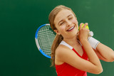 Tennis young girl player on court. - 208868874