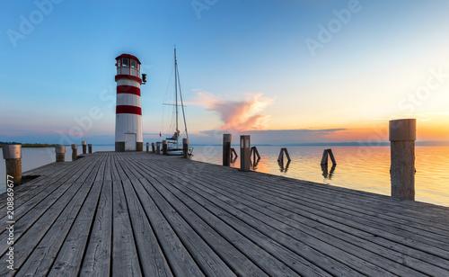 Foto Murales Beautiful sunset at lighthouse, Austria