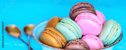 Cake macaron or macaroon on turquoise banner panoramic background, pastel colors, tasty food card