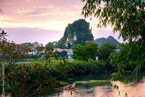 Fotobehang Guilin Sunset scene in Guilin, China, with stunning rock formation
