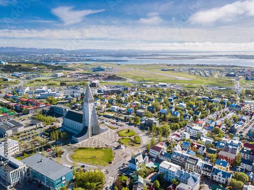 Leinwanddruck Bild Reykjavik Iceland city scape frop the top with Hallgrimskirkja church. Aerial photo. religious building