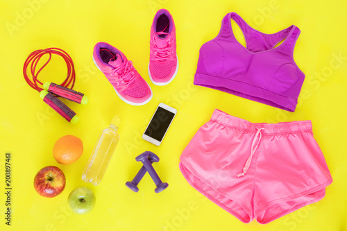 Wall mural Different workout essentials on yellow floor