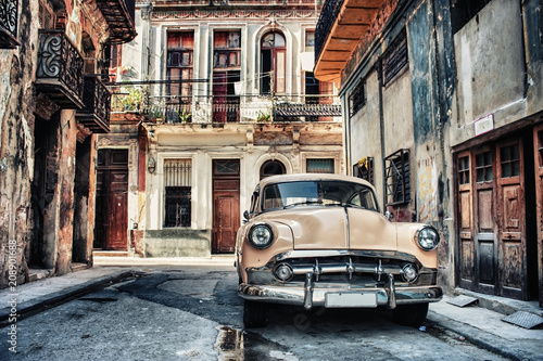 Old classic car in a street of havana with buildings in background - 208901688