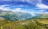 Panorama of the Alps in summer. View on the Emosson dam in Switzerland during Tour du Mont Blanc hike