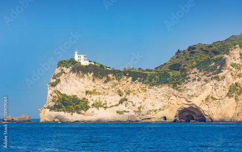 Fotobehang Vuurtoren Cape Miseno Lighthouse, Napoli, Italy in sunny summer day