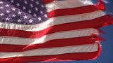 close up of waving weathered, ragged national flag of USA  with fabric structure, symbol of politics and political apathy - 208912042
