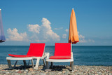 chaise lounges on the beach - 208912499