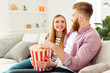 Leinwanddruck Bild - Bearded hipster two partners friendship day lifestyle vacation hobby freetime happiness concept. Joyful rejoicing lovely people watching comedy together eating pop-corn from basket box on holidays