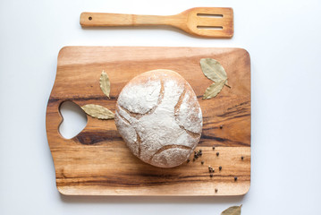 Bread on the wooden cutting board
