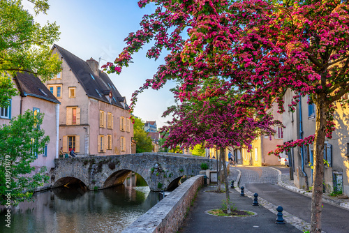 Leinwanddruck Bild Eure River embankment with old houses in a small town Chartres, France