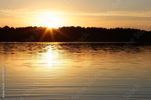 Fotobehang Zonsopgang View on a lake during sunrise