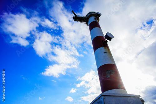 Fotobehang Vuurtoren Red and White Lighthouse