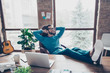 Cool, cheerful, smiling director put legs in shoes on table, sitting on chair at desktop in workstation, having hands behind the head, remembering good memories, dreaming