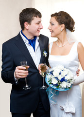 bridegroom and bride with champagne
