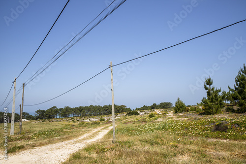 NAZARE, PORTUGAL - MAY 18, 2018. Electricity poles and lines in the Portuguese landscape