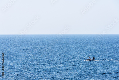 Fotobehang Zeilen Boat sailing in the Mediterranean Sea in Catalonia, Spain