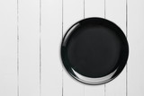 Black Empty Ceramic Plate on white wooden table,top view. - 208934280