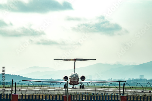 Airplane flying in the sky, 2018 June 10 ,Taiwan, Taipei, Songshan Airport