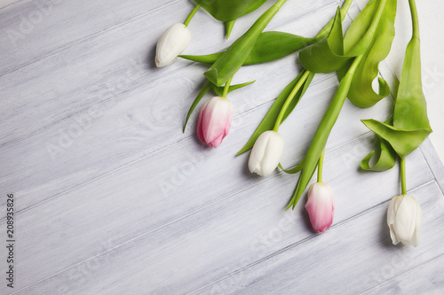 Bouqette of tulips on a wooden background. Top view. Greeting card