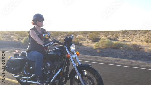 Woman on Motorcyle with Dog