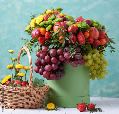 a beautiful bouquet of fruits and flowers for the birthday of strawberries grape peaches