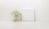 Square canvas mockup, white flowers, styled stock photo - 208961815