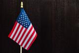 American Flag on Dark Wood Table - 208965040