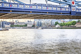 Part of Tower Bridge, Thames River and the city at background. London, England