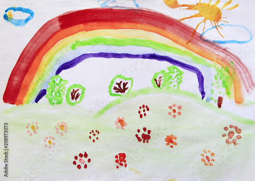 Child's drawing of clearing with flowers rainbow and colored bushes