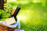 Picnic basket in summer park - 208973228