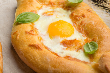 Khachapuri traditional Georgian cheese and egg-filled bread