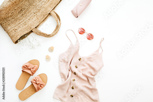 Foto Murales Summer pink feminine clothes and accessories on white background. Flat lay, top view. Summer fashion concept.