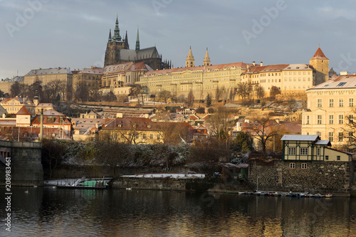 Poster Sunny snowy early morning Prague Lesser Town with gothic Castle above River Vltava, Czech republic