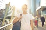 Man walking on a bridge - 208990440