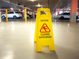 Warning janitorial sign of cleaning in progress in car park to warn passersby for safety. - 208997817