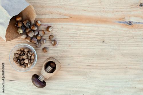 Fotobehang Koffiebonen Fresh Hazelnuts with nut cracker