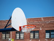 Outdoor basketball hoop with the net swishing after a made shot