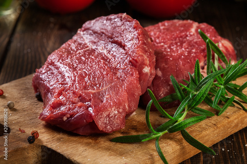 Fotobehang Steakhouse Fresh raw beef steak sirloin with rosemary